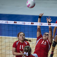 Pine Hill Warriors Maurie Daniels (13) cleanly dinks one over the net for an attack. The Lady Longhorns won 3-0 at the Santa Ana Star Center in Rio Rancho on Friday.