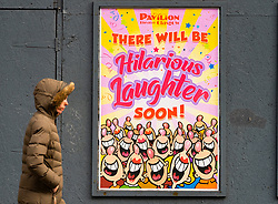 Glasgow, Scotland, UK. 23 March 2021. On the first anniversary of the coronavirus pandemic lockdown the streets in Glasgow city centre are still quiet with only essential shops open. Pic; poster by entertainment and theatre industry looking on the bright side. Iain Masterton/Alamy Live News