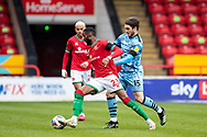Emmanuel Osadebe of Walsall   and Forest Green Rovers Jordan Moore-Taylor(15) battles for possession during the EFL Sky Bet League 2 match between Walsall and Forest Green Rovers at the Banks's Stadium, Walsall, England on 10 April 2021.