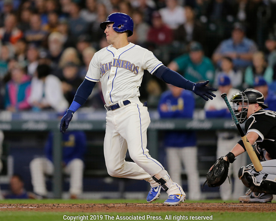 Seattle Mariners' Dylan Moore hits an RBI single against the Chicago White Sox during a baseball game, Sunday, Sept. 15, 2019, in Seattle. (AP Photo/John Froschauer)