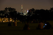 London 5/7/12. Seen from a park in south London, locals watch with increasing disappointment across to an anti climactic laser show across London during the inauguration of the capital's newest addition to its skyline, the Qatari-financed skyscraper, the Shard, the tallest building in western Europe. The light show was supposed to be visible across the capital and Londoners gathered in high points to see the spectacle. Renzo Piano's Shard is a 310m (1,016ft) tapering steel structure in the heart of the London borough of Southwark.