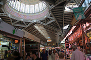 Stalls inside central market building, city of Valencia, Spain glass domed roof