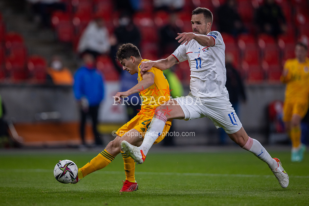 PRAGUE, CZECH REPUBLIC - Friday, October 8, 2021: Wales' Daniel James scores the second goal, to make the score 2-2, under pressure from Czech Republic's Filip Novák during the FIFA World Cup Qatar 2022 Qualifying Group E match between Czech Republic and Wales at the Sinobo Stadium. The game ended in a 2-2 draw. (Pic by David Rawcliffe/Propaganda)