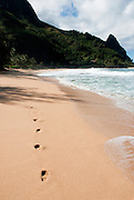 Footprints lead the way towards the mountains on the northeastern edge of Kauai. This was seen in the movie 'South Pacific'.