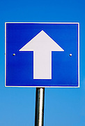 One way traffic sign on blue sky background