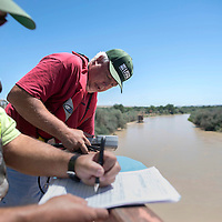 080915      Cayla Nimmo<br /> <br /> Rob Henrion, right, and Mike Jimenez from the United States Geological Survey take a cross section of reading from the San Juan River off the 491 overpass in Shiprock Sunday. The data collected will be compared with historical reading from the site to gauge the level of contamination from the wastewater spill at Colorado's Gold King Mine Wednesday.