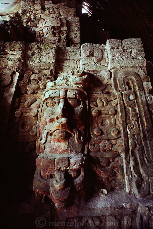 Mayan ruins at the Pyramid of the Masks at Kohunlich,  Mexico, Yucatan. Built prior to 500 AD, it is unknown whether they represent rulers or gods.