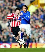Photo. Aidan Ellis<br />Everton v Southampton. FA Barclaycard Premiership 22/02/03.<br />Everton Li Tie and Southampton Matt Oakley<br />.