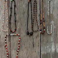 Handmade Indian necklaces hang on a wall in San Juan de Yanayacu village in Peru's Amazon Jungle.