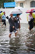 Bangkok citizens coping with a recent monsoon rain