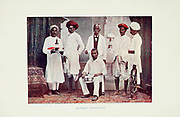 Group photograph of Bombay Servants Typical Pictures of Indian Natives Being reproduction from Specially prepared hand-colored photographs. By F. M. Coleman (Times of India) Seventh Edition Bombay 1902