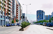 Street scene with typical colourful houses on a wide main road. Tirana capital. Albania, Balkan, Europe.