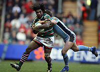 Photo: Rich Eaton.<br /> <br /> Leicester Tigers v Cardiff Blues. Heineken Cup. 13/01/2007.Seru Rabeni is tackled by Chris Czekaj of Cardiff