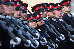 Officer cadets march past the Duke of Cambridge as he represents the Queen as the Reviewing Officer at The Sovereign's Parade at Royal Military Academy Sandhurst in Camberley.