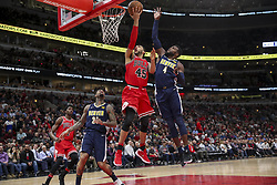 March 21, 2018 - Chicago, IL, USA - The Chicago Bulls' Denzel Valentine (45) goes up for a basket past the Denver Nuggets' Paul Millsap (4) during the first half at the United Center in Chicago on Wednesday, March 21, 2018. The Nuggets won, 135-102. (Credit Image: © Armando L. Sanchez/TNS via ZUMA Wire)