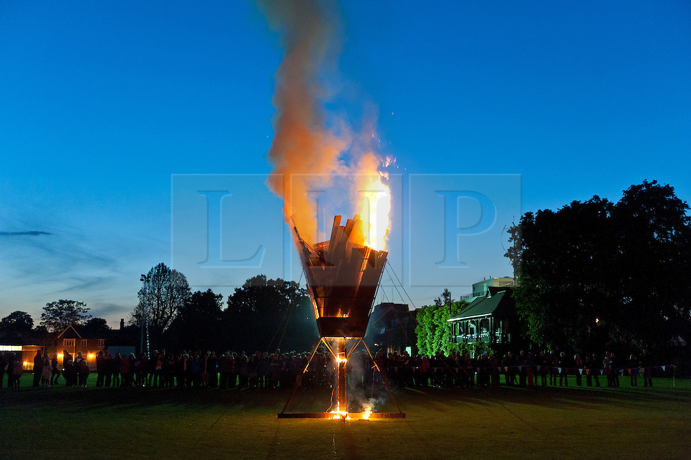 © Licensed to London News Pictures. 04/06/2012. London, UK.  A Jubilee Beacon burns at Kings College School, Wimbledon, London.  It is one of a network of over 4000 Beacons lit by communities and others throughout the United Kingdom, Channel Islands and the Isle of Man, along with the Commonwealth.  The Royal Jubilee celebrations. Great Britain is celebrating the 60th  anniversary of the countries Monarch HRH Queen Elizabeth II accession to the throne this weekend.    Photo credit : Richard Isaac/LNP