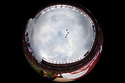 An American flag is unfurled over the field as jets fly over Broncos Stadium at Mile High during the playing of the National Anthem before the Denver Broncos NFL week 4 regular season football game against the Kansas City Chiefs on Monday, Oct. 1, 2018 in Denver. The Chiefs won the game 27-23. (©Paul Anthony Spinelli)