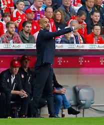 MUNICH, GERMANY - OCTOBER 18: Josep Guardiola head coach of Bayern Munich issues instructions to his team during the Bundesliga match between Bayern Munich and Werder Bremen. October 18, 2014 in Munich, Germany. Photo mandatory by-line: Mitchell Gunn