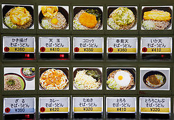 Buttons and images of meals on a food vending machine at a Tokyo restaurant