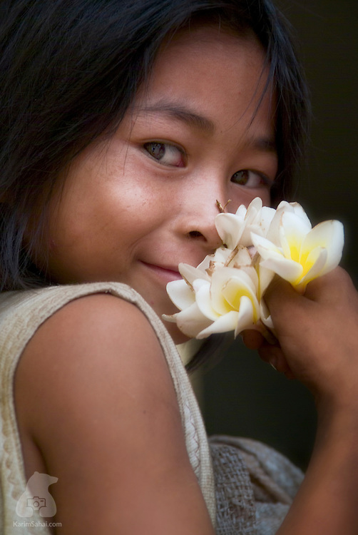 A young khmer girl holding frangipani flowers