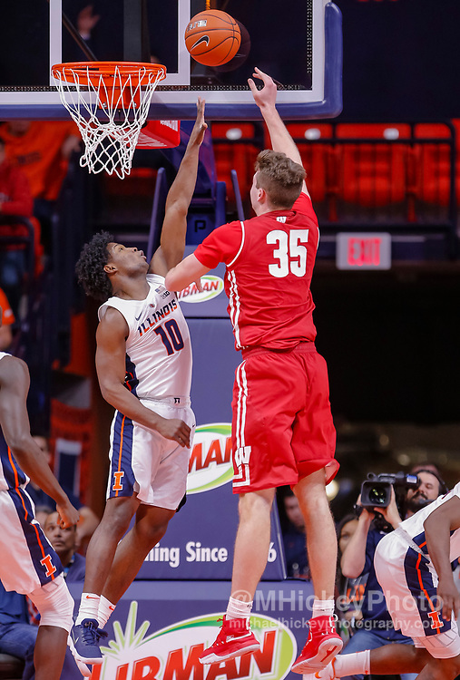 CHAMPAIGN, IL - JANUARY 23: Andres Feliz #10 of the Illinois Fighting Illini defends against the shot of Nate Reuvers #35 of the Wisconsin Badgers at State Farm Center on January 23, 2019 in Champaign, Illinois. (Photo by Michael Hickey/Getty Images) *** Local Caption *** Andres Feliz; Nate Reuvers
