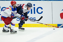 Yevgeni Dadonov of Russia vs Marek Viedensky of Slovakia during Ice Hockey match between Slovakia and Russia at Day 10 in Group B of 2015 IIHF World Championship, on May 10, 2015 in CEZ Arena, Ostrava, Czech Republic. Photo by Vid Ponikvar / Sportida