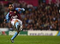 Photo. Daniel Hambury.<br />Carling Cup.<br />22/09/2004.<br />Aston Villa V Queens Park Rangers. <br />Aston Villa's Nolberto Solano score his sides third goal