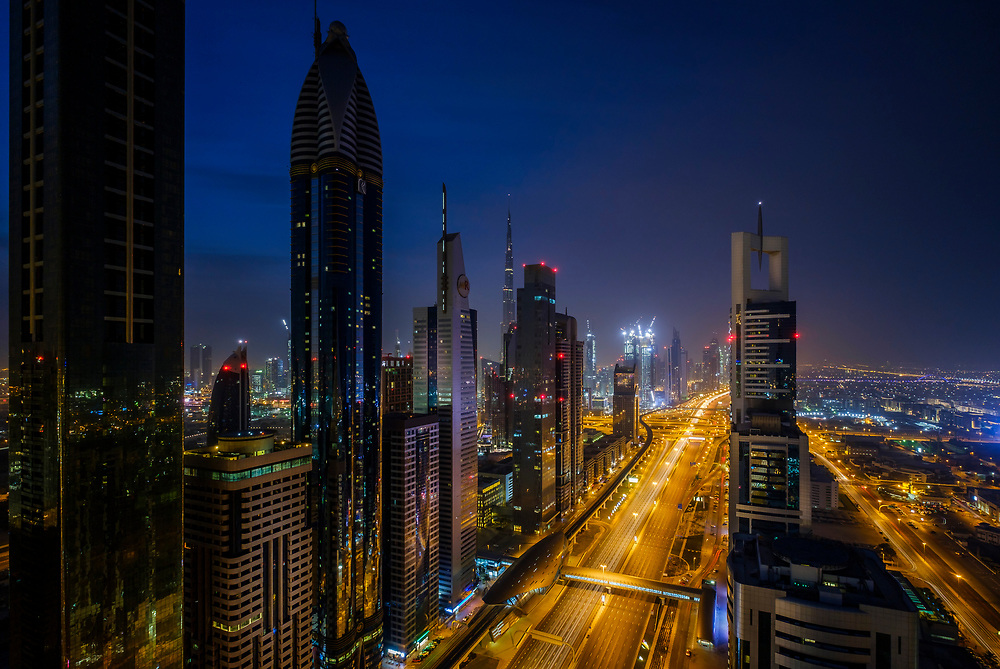 UNITED ARAB EMIRATES, DUBAI - CIRCA JANUARY 2017: Sheikh Zayed Road at dawn in Dubai. This is the main artery of the city and is home for most of the Dubai skyscrapers.