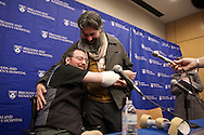 20141125, November 25, 2014, Boston, MA, USA; Brigham and Women's Hospital Plastic Surgery Transplantation Program, in coordination with the hospital's entire transplant team, and the New England Organ Bank, announced the double arm transplant for William 'Will' Lautzenheiser at a media event on Tuesday morning. Will hugs his partner Angel during the media question and answer part of the program.<br /> <br /> <br /> BACKGROUND: Brigham and Women's Hospital Plastic Surgery Transplantation Program, in coordination with the hospital's entire transplant team, and the New England Organ Bank, worked throughout an entire night to replace both forearms of William 'Will' Lautzenheiser in a bilateral mid-forearm transplant procedure, the third of it's kind for the Brigham and Women's Hospital in Boston MA. The forearm transplant team, led by plastic surgeon Dr. Matthew J. Carty, MD, began their surgical procedures shortly after 10 p.m. and transformed patient Will Lautzenheiser was transported to the tower ICU floor for recovery before 11 a.m. the following day.<br /> <br /> ( 2014 © lightchaser photography )