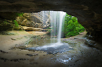 La Salle Falls tumbles over a small cave in Starved Rock State Park. With all the rain Illinois received in June the waterfalls here were flowing quite a bit. The cool shady canyons provide a relief from the summer heat.