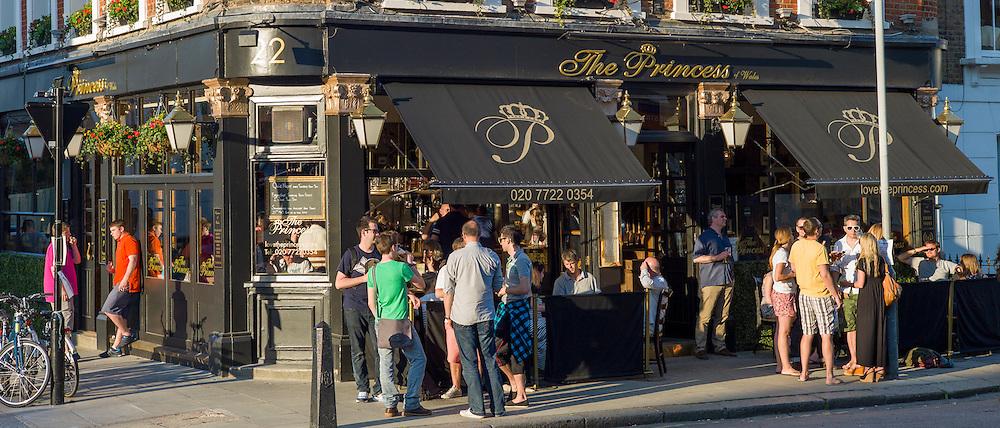 Customers enjoying warm weather at The Princess traditional London pub in Primrose Hill, London