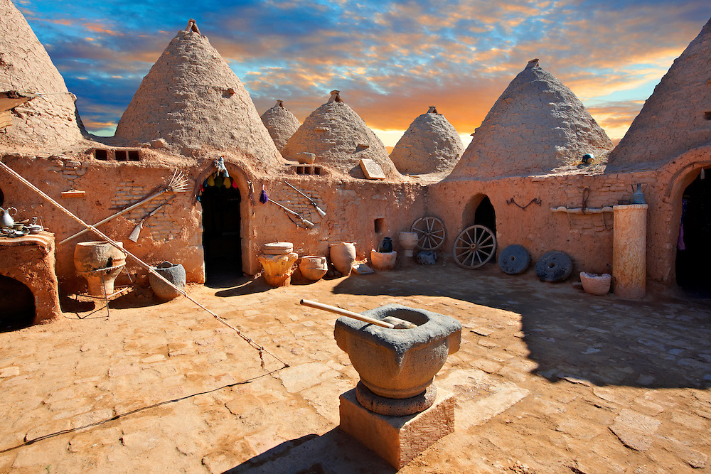"""Pictures of the beehive adobe buildings of Harran, south west Anatolia, Turkey.  Harran was a major ancient city in Upper Mesopotamia whose site is near the modern village of Altınbaşak, Turkey, 24 miles (44 kilometers) southeast of Şanlıurfa. The location is in a district of Şanlıurfa Province that is also named """"Harran"""". Harran is famous for its traditional 'beehive' adobe houses, constructed entirely without wood. The design of these makes them cool inside. 24 .<br /> <br /> If you prefer to buy from our ALAMY PHOTO LIBRARY  Collection visit : https://www.alamy.com/portfolio/paul-williams-funkystock/harran.html<br /> <br /> Visit our TURKEY PHOTO COLLECTIONS for more photos to download or buy as wall art prints https://funkystock.photoshelter.com/gallery-collection/3f-Pictures-of-Turkey-Turkey-Photos-Images-Fotos/C0000U.hJWkZxAbg ."""