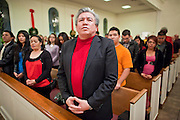 19 DECEMBER 2010 - PHOENIX, AZ: ELIAS BERMUDEZ, a supporter of immigrants' rights, participates in a prayer service for the DREAM Act in Phoenix. About 100 supporters of the DREAM Act gathered at First Congregational Church of Christ in Phoenix Sunday night, December 19, for a prayer vigil in support of the DREAM Act, which was defeated in the US Senate Saturday, Dec. 18. The DREAM Act, was supported by the Obama administration, and was an important part of the administration's immigration reform platform. The defeat of the DREAM Act, which would have established a path to citizenship for undocumented immigrants who were brought to the US by their parents when they were children, set back the President's immigration reform efforts.    PHOTO BY JACK KURTZ