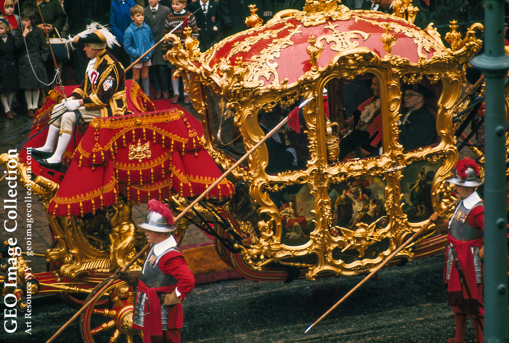 Lord Mayor of London rides in resplendent coach flanked by pikemen.
