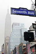 March 16, 2013 - New York, NY, U.S. -  Looking up at snowy scene at intersection of Seventh Ave and W. 33rd Street, with Empire State Building in Background, on day of the 252nd annual NYC St. Patrick's Day Parade.