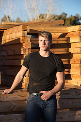 hot blond man in a black tee shirt on a construction site