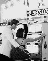 Young couple gambling at slot machine in Las Vegas