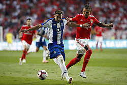 October 7, 2018 - Lisbon, Portugal - Hector Herrera of Porto (L) vies for the ball with Ljubomir Fejsa of Benfica (R)  during the Portuguese League football match between SL Benfica and FC Porto at Luz Stadium in Lisbon on October 7, 2018. (Credit Image: © Carlos Palma/NurPhoto/ZUMA Press)