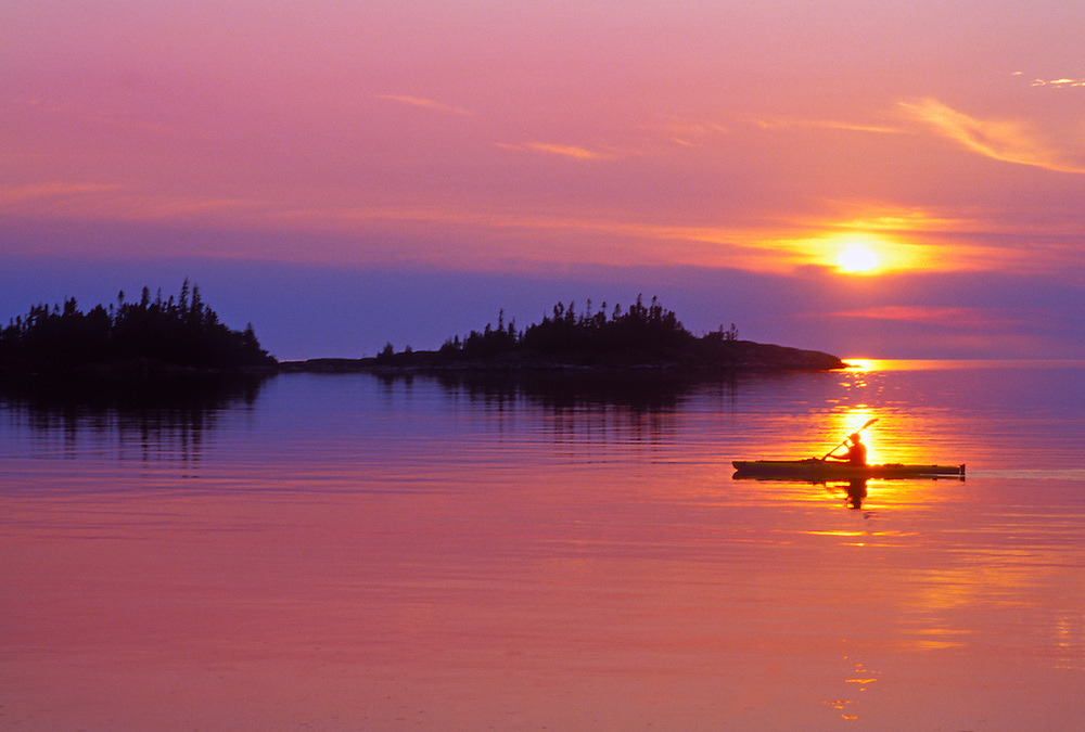 A kayaker is silhouetted at sunset on Lake Superior in Pukaskwa National Park near White River, Ontario.