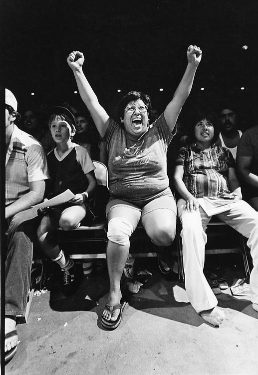 ©1992 championship wrestling spectator cheering on her favorite guy.