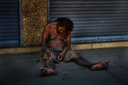 Homeless man asleep on street in Bangkok, Thailand.
