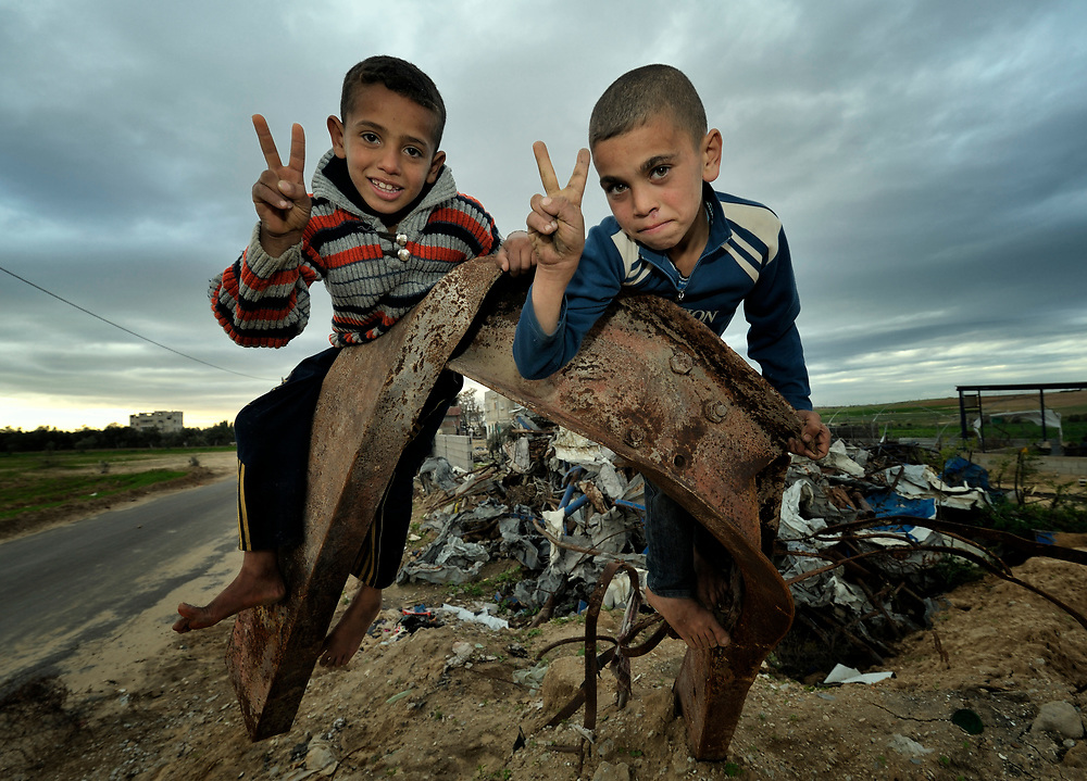 Bilal Al-Shawish (left), 7, and his 9-year old brother Mohanad, climb on the twisted rubble of what was once a greenhouse before the Israeli bombing of their family's farm in Johor Al-Deek, a section of the Bureij refugee camp in Gaza. The farm is being reactivated today with help from a new well and water pump provided by Dan Church Aid--a member of the ACT Alliance--to replace a well and pump destroyed by the Israeli military during Operation cast Lead.
