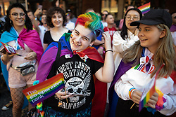 © Licensed to London News Pictures . 24/08/2019. Manchester, UK. The watching crowd . The 2019 Manchester Gay Pride parade through the city centre , with a Space and Science Fiction theme . Manchester's Gay Pride festival , which is the largest of its type in Europe , celebrates LGBTQ+ life . Photo credit: Joel Goodman/LNP
