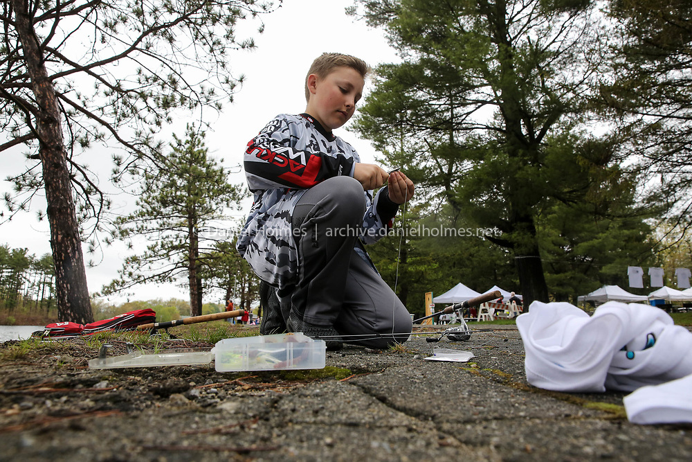 (5/6/17, WESTBOROUGH, MA) Jace Capes, 13, of  Northborough, puts a worm on a hook during the Civic Club's 10th Annual Fishing Challenge at Sandra Pond in Westborough on Saturday. [Daily News and Wicked Local Photo/Dan Holmes]