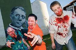 Slingshots Top Zombies Alex Noble, Noel Davies-Atack and Paul Byrne in front of the mural of Harry Brearley that commemorates 100 years since he discovered Stainless Steel in Sheffield Sheffield on Tuesday evening ahead of the game 2.8 Hours Later which reaches the city in August <br /> <br /> 30 June 2015<br />  Image © Paul David Drabble <br />  www.pauldaviddrabble.co.uk
