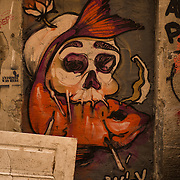 """Graffiti (/ɡrəˈfiːti/; Italian: [ɡrafˈfiːti]; plural of graffito: """"a graffito"""", but """"these graffiti"""") are writing or drawings that have been scribbled, scratched, or painted illicitly on a wall or other surface, often in a public place. Graffiti range from simple written words to elaborate wall paintings, and they have existed since ancient times, with examples dating back to Ancient Egypt, Ancient Greece, and the Roman Empire.<br /> <br /> In modern times, paint (particularly spray paint) and marker pens have become the most commonly used graffiti materials. In most countries, marking or painting property without the property owner's consent is considered defacement and vandalism, which is a punishable crime.<br /> <br /> Graffiti may also express underlying social and political messages and a whole genre of artistic expression is based upon spray paint graffiti styles. Within hip hop culture, graffiti have evolved alongside hip hop music, b-boying, and other elements. Unrelated to hip-hop graffiti,[citation needed] gangs use their own form of graffiti to mark territory or to serve as an indicator of gang-related activities.<br /> <br /> Controversies that surround graffiti continue to create disagreement amongst city officials, law enforcement, and writers who wish to display and appreciate work in public locations. There are many different types and styles of graffiti; it is a rapidly developing art form whose value is highly contested and reviled by many authorities while also subject to protection, sometimes within the same jurisdiction."""