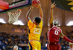 Feb 2, 2019; Morgantown, WV, USA; West Virginia Mountaineers forward Esa Ahmad (23) dunks the ball during the second half against the Oklahoma Sooners at WVU Coliseum. Mandatory Credit: Ben Queen-USA TODAY Sports