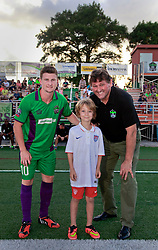 20 June 2015. New Orleans, Louisiana.<br /> National Premier Soccer League. NPSL. <br /> Jesters 1 - Knoxville 1.<br /> The New Orleans Jesters head coach Kenneth Farrell, team captain Keir Hannity and birthday boy Amos Liles  before the game at the Pan American Stadium. Jesters drew 1-1 with Knoxville.<br /> Photo; Charlie Varley/varleypix.com