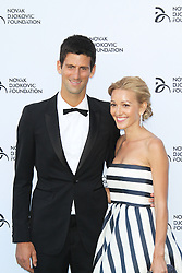© Licensed to London News Pictures. Novak Djokovic and Jelena Ristic at the Novak Djokovic Foundation London gala dinner, The Roundhouse, London UK, 08 July 2013. Photo credit: Richard Goldschmidt/LNP