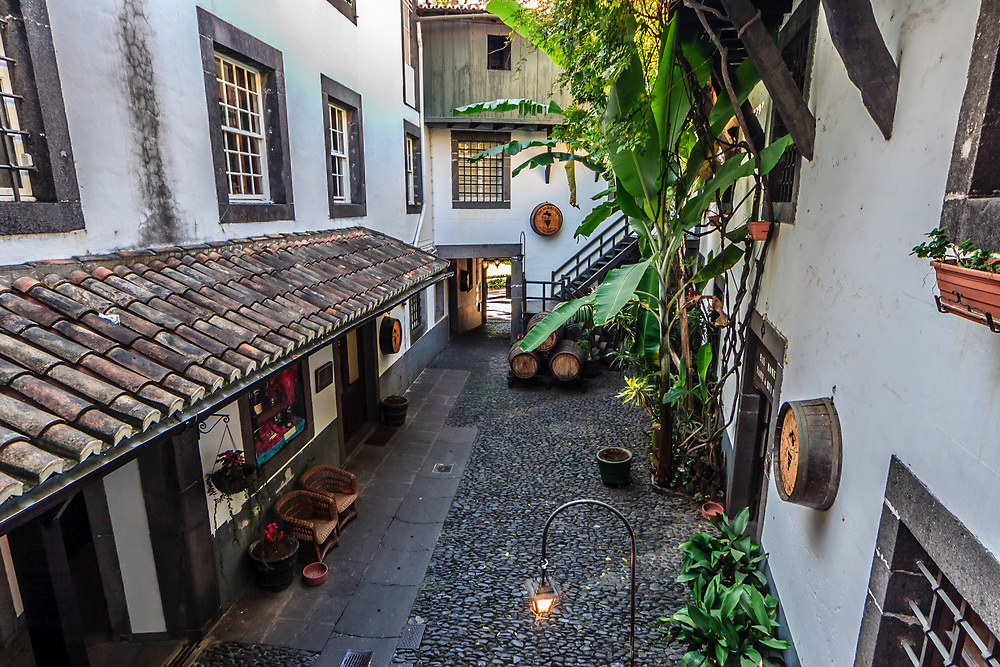 Winery courtyard in Funchal, Madeira. Blandy's Wine Lodge located in a 17 th century building  was once part of an old Franciscan monastery.